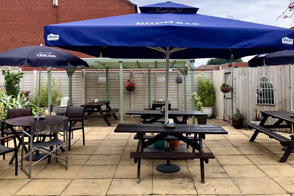 The new sheltered seating in the pub's beer garden