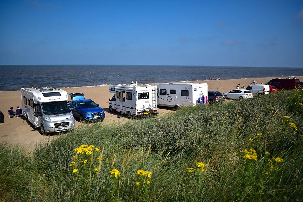 Cars and motorhomes next to the dunes on Huttoft Car Terrace
